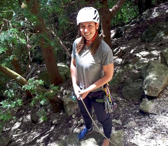 Kate wearing helmet ties into rope