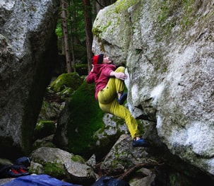 Climber in bright colours bouldering
